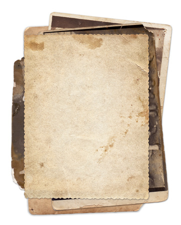Stack of old vintage photos with stains and scratches background isolated Foto de archivo