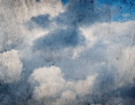 moody background: Vintage grunge background of blue sky with clouds Stock Photo