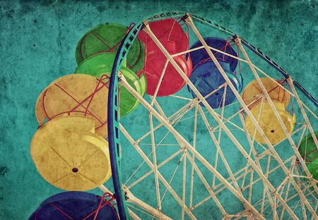 Vintage grunge background with colorful ferris wheel photo