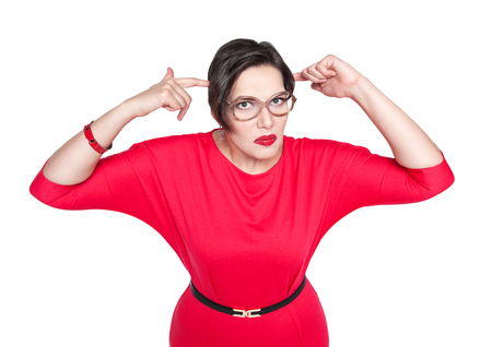 stupid body: Beautiful plus size woman gesturing fingers against her temple isolated Stock Photo