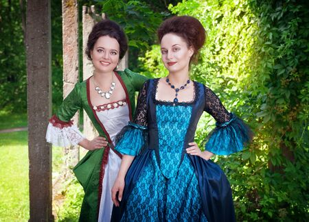 ruche: Two young beautiful women in long medieval dresses outdoor Stock Photo