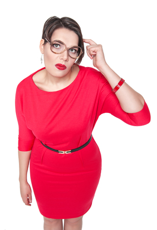 stupid body: Plus size woman in glasses gesturing finger against her temple isolated