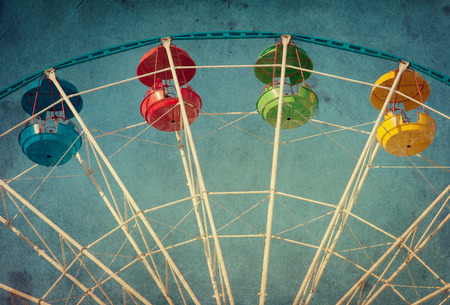 fun day: Vintage grunge background with colorful ferris wheel Stock Photo