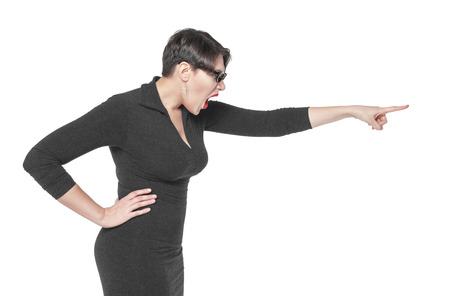 female teacher: Angry teacher woman pointing out isolated over white