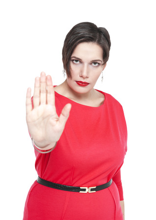 disallow: Beautiful plus size woman in red dress making stop sign gesture isolated Stock Photo