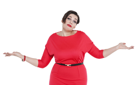 Beautiful plus size woman in red dress shrugs her shoulders isolated photo