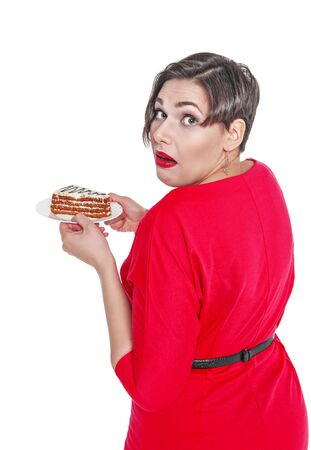 unawares: Beautiful plus size woman eating cake isolated over white Stock Photo