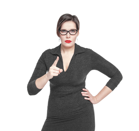 threatens: Strict teacher woman threatens by finger isolated over white Stock Photo