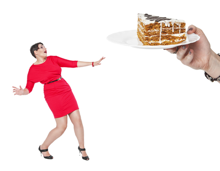 woman red dress: Diet and nutrition concept. Plus size woman afraid cake isolated Stock Photo