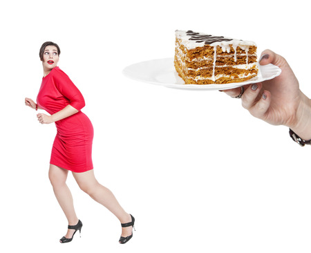 stressed woman: Diet and nutrition concept. Plus size woman afraid cake isolated Stock Photo