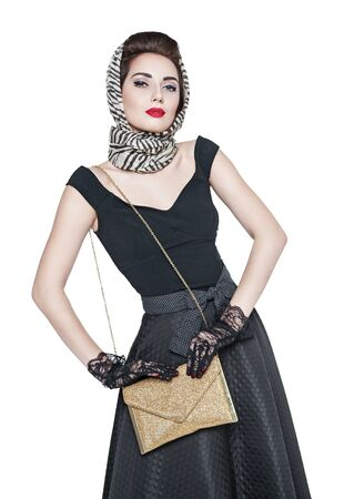 reticule: Young beautiful woman in retro pin-up style with purse isolated over white
