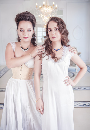 Two beautiful young women in old-fashioned negligee Stock Photo