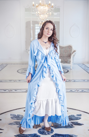 ruche: Beautiful young woman in blue dressing gown with frill Stock Photo