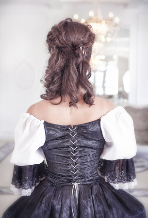 ruche: Beautiful medieval woman in black and white dress, back Stock Photo