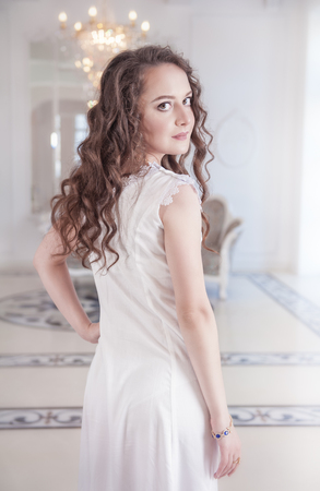 underskirt: Beautiful young woman in old-fashioned negligee indoor Stock Photo