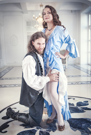 ruche: Handsome man in medieval costume seduces beautiful woman with long hair
