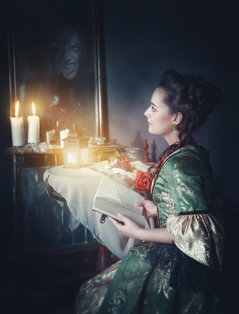 girl dress: Beautiful woman with book in retro dress and ghost in the mirror