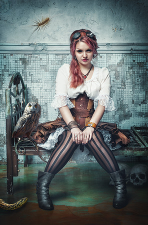 Beautiful steampunk witch sitting in the abandoned room