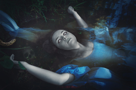 drowned: Terrible drowned dead ghost woman lying in the water