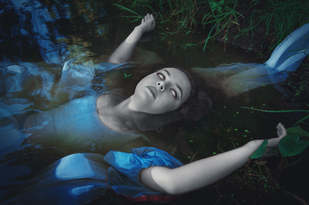 ugly girl: Terrible dead ghost woman lying in the water