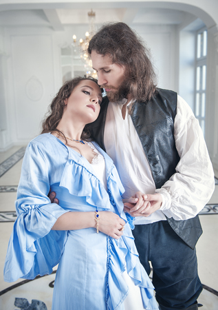 seducer: Beautiful romantic couple woman and man in medieval clothes