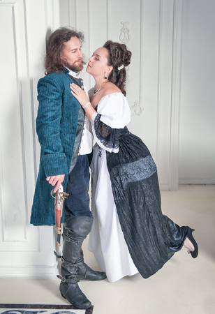 pompous: Beautiful couple woman and man in medieval clothes in the room Stock Photo