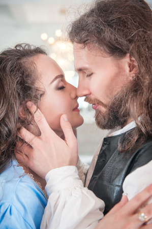 Beautiful passionate couple woman and man in medieval clothes Stock Photo