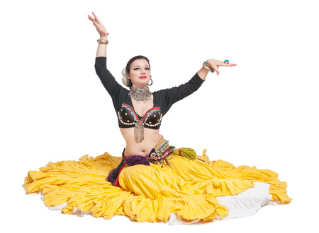 indian style sitting: Beautiful exotic belly tribal dancer woman isolated