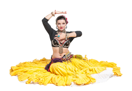 sexy girl sitting: Beautiful exotic belly tribal dancer woman isolated