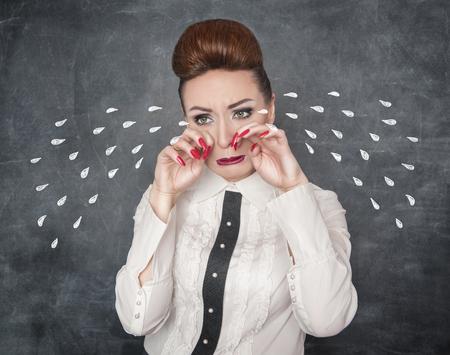 parody: Crying sad woman on the blackboard background Stock Photo