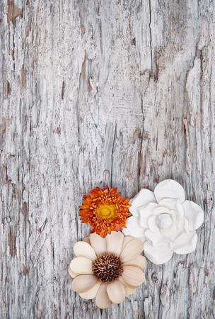 Grunge background with dry flowers on the old weathered wood