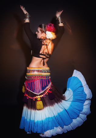 exotic dancer: Beautiful exotic belly tribal dancer woman on black background Stock Photo