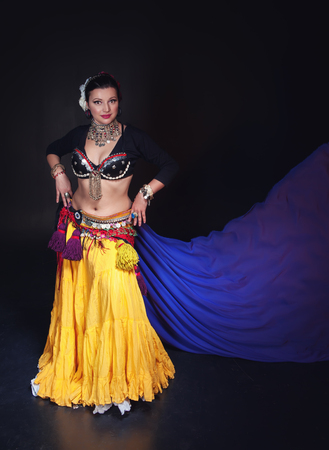 cute girl smiling: Beautiful exotic belly tribal dancer with blue shawl woman on black background