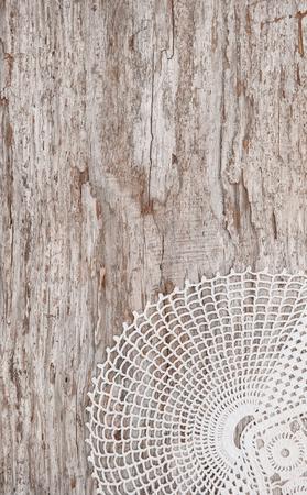 tela de encaje en el fondo de madera vieja