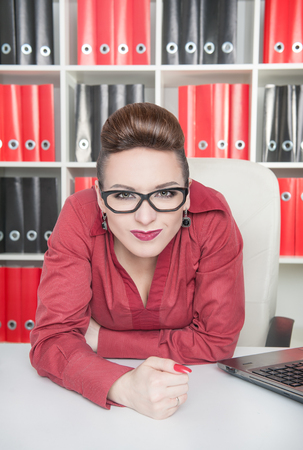 displeased: Angry displeased business woman with glasses in office Stock Photo