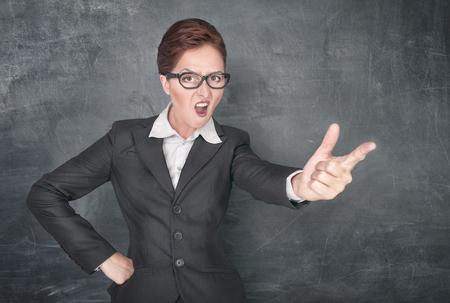 bawl: Angry screaming teacher on the school blackboard background