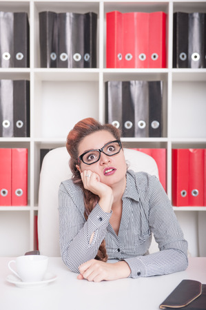 slog: Bored business woman working in office. Overwork concept