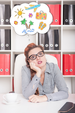 overwork: Bored business woman dreaming about holiday in office. Overwork concept