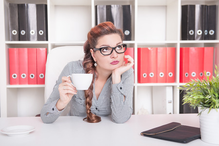 overwork: Bored business woman working in office. Overwork concept