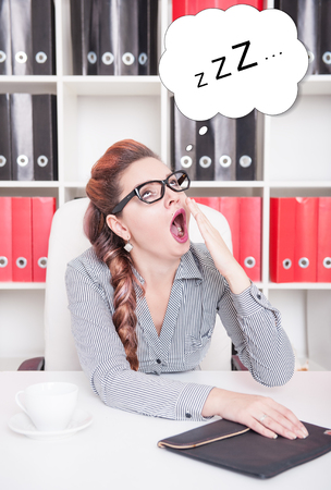 slog: Bored business woman yawning in office. Overwork concept Stock Photo