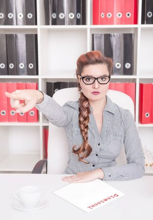 dismissive: Angry business woman boss pointing out in office. Dismissal concept Stock Photo