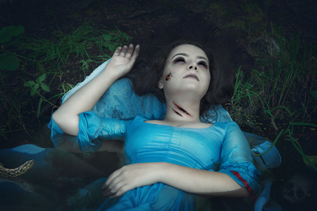 terrible: Terrible drowned dead ghost woman lying in the water