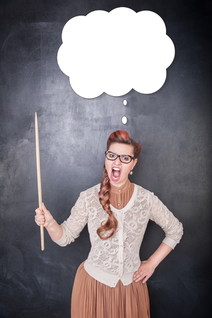 Angry screaming teacher with pointer on the chalkboard blackboard background