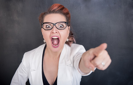 expel: Angry screaming teacher pointing out on chalkboard blackboard background