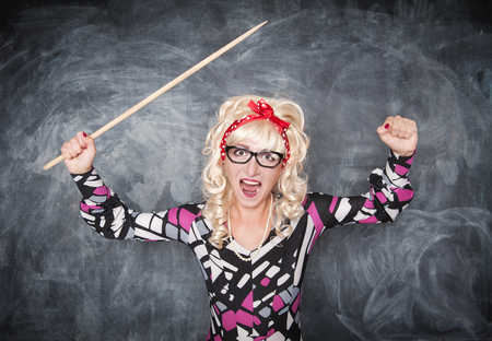expel: Angry screaming retro teacher with pointer on chalkboard blackboard background