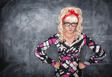 menacing: Angry retro teacher on chalkboard blackboard background