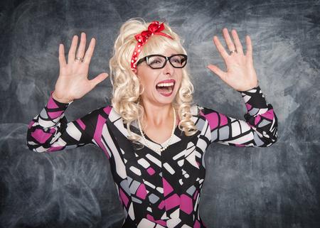 Crazy screaming retro woman on chalkboard blackboard background