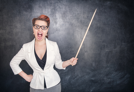 bawl: Angry screaming teacher with pointer on the chalkboard blackboard background