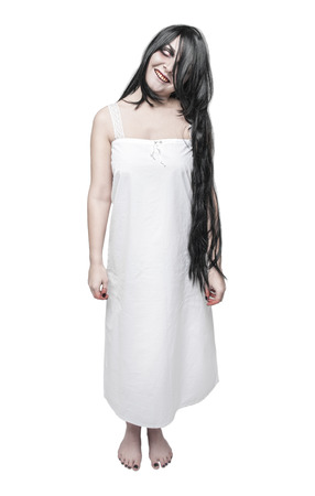 Mystical ghost crazy woman in white long shirt isolated on white Stock Photo