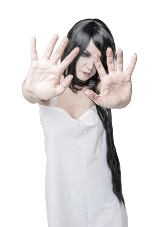 Mystical ghost woman in white long shirt isolated. Focus on hands
